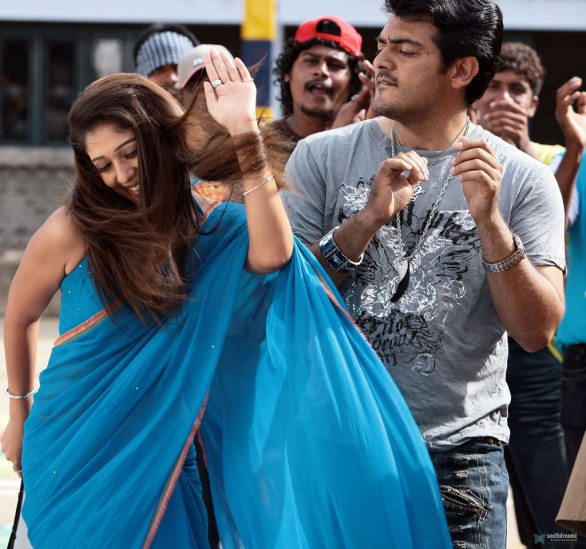 aegan ajith nayantara love making stills 586x549 Nayantara expects 3Cr salary for Simbu film